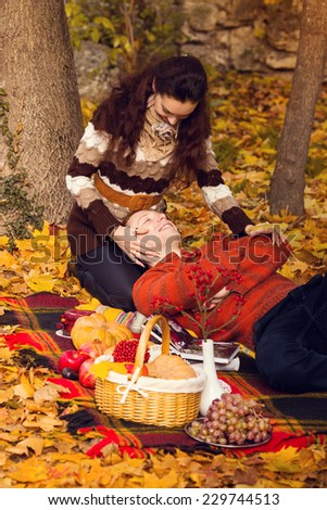 Happy young couple in love meeting on the autumn leaf . Autumn set. . love, relationship, family and people concept -