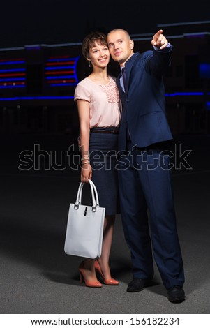Happy young couple in love on the night city street - stock photo