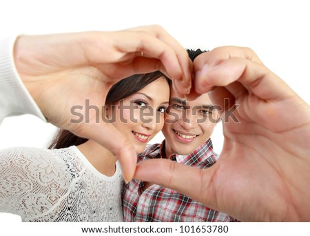 Happy young couple in love showing heart with fingers isolated over white background - stock photo