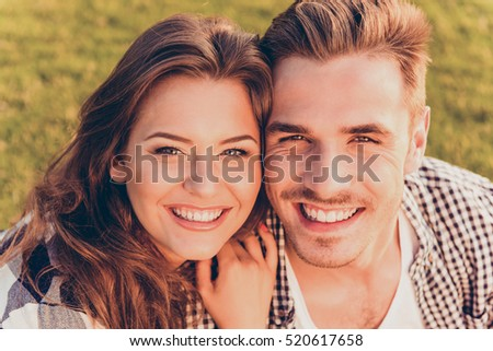happy young couple in love smiling.