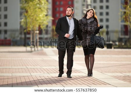 Happy young couple in love walking on city street Stylish fashion model outdoor