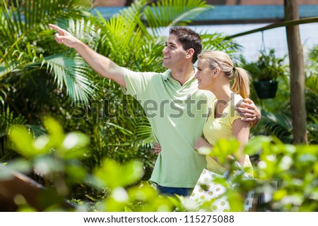 happy young couple in nursery - stock photo