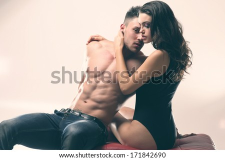 Happy young couple in sexual intercourse .Erotic photo, glamour colors. - stock photo