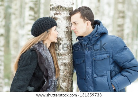 Happy Young Couple in Winter birchwood walking