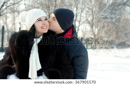 Happy young couple in winter outdoors. love
