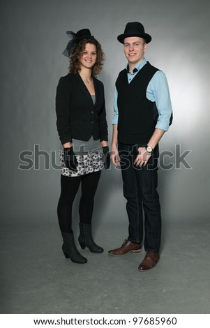 Happy young couple isolated on grey background