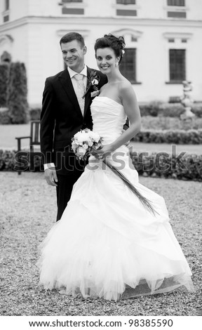 Happy young couple just married - wedding day - BW photo - stock photo
