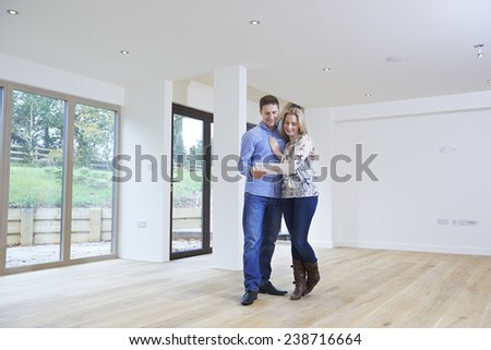 Happy Young Couple Looking At Details Of New Home - stock photo