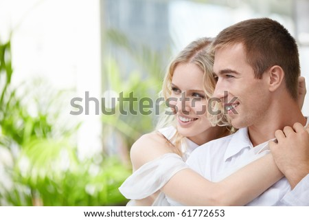 Happy young couple looking to one side - stock photo