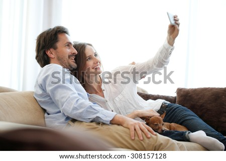happy young couple making selfie - stock photo