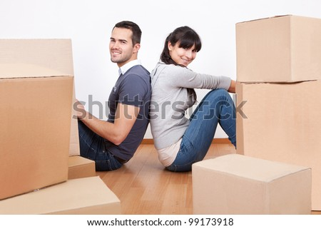Happy young couple moving into new house