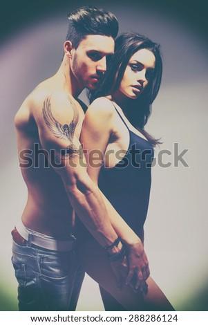 Happy young couple. No brand. Fashion colors. Retro style. - stock photo