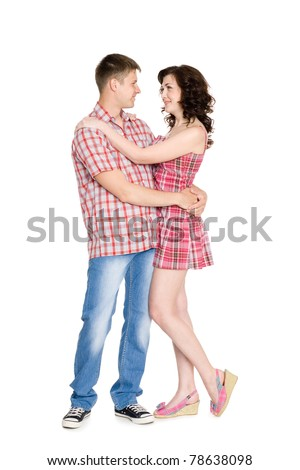 Happy young couple on a white background.