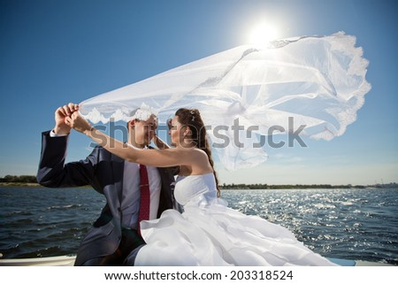 happy young couple on the yacht - stock photo