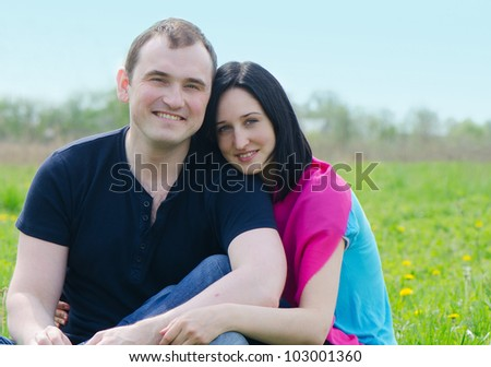 Happy young couple outdoor in spring