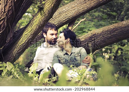 happy young couple outdoors - stock photo
