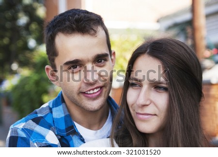 Happy young couple outdoors in autumn