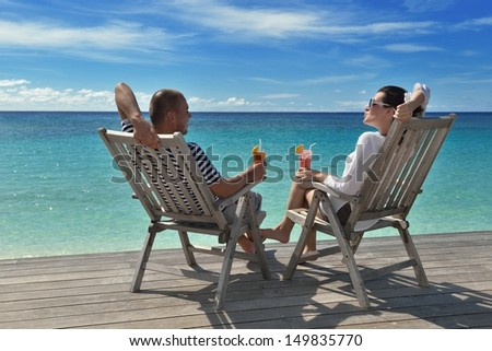 happy young couple relax and take fresh drink at summer vacation