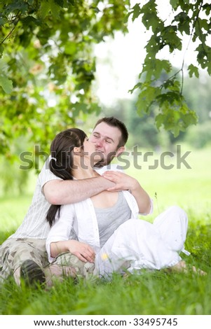 happy young couple relaxing in park