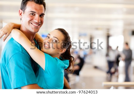 happy young couple reunion at airport