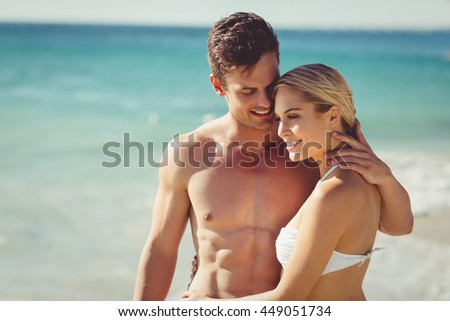 Happy young couple romancing on beach