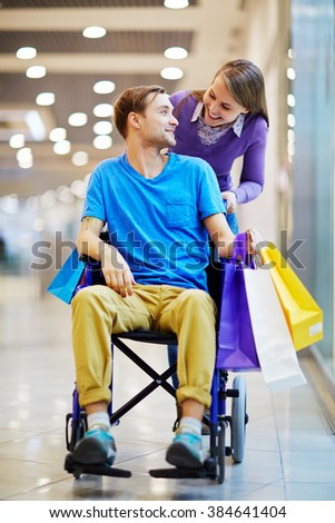 Happy young couple shopping together - stock photo