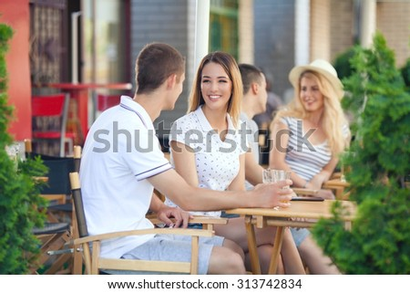 Happy young couple sitting in a outdoor cafe