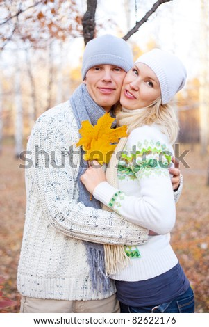 happy young couple spending time outdoor in the autumn park - stock photo