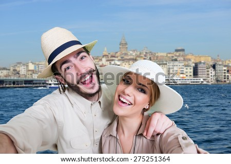 Happy, young couple taking a self portrait photo, selfie in front of Bosphorus in Istanbul, Turkey - stock photo