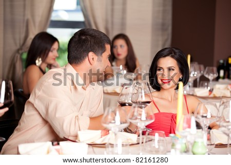 happy young couple toasting restaurant table