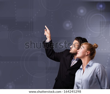 Happy young couple touching copy space - stock photo