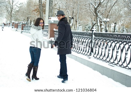 Happy Young Couple Walking in Winter Park - stock photo