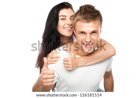 Happy young couple with his thump up, isolated on white background - stock photo