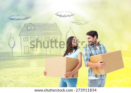 Happy young couple with moving boxes against field with glowing sky - stock photo