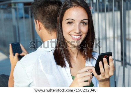 Happy young couple with smart phone - stock photo