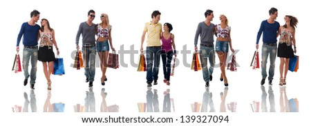 Happy young couples coming back from shopping collection. - stock photo