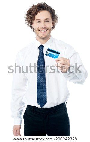Happy young executive holding a credit card - stock photo
