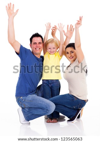 happy young family arms up on white