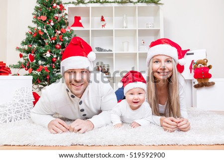 Happy young family celebrating Christmas at home