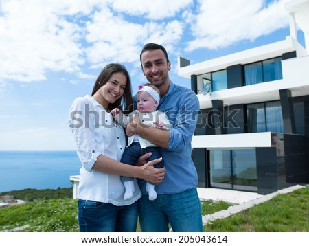 happy young family couple with beautiful new born baby have fun at modern  home - stock photo