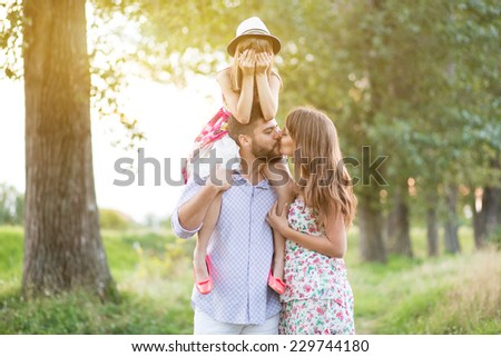 Happy young family enjoy on picnic - stock photo
