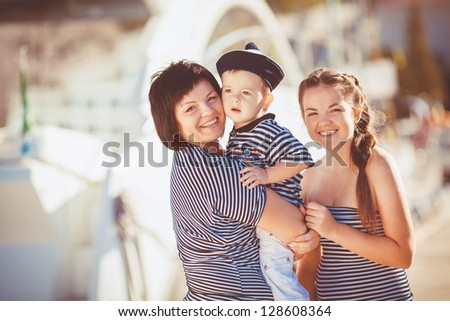 happy young family have fun and live healthy lifestyle on beach - stock photo