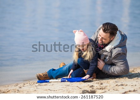 happy young family have fun on beach - stock photo