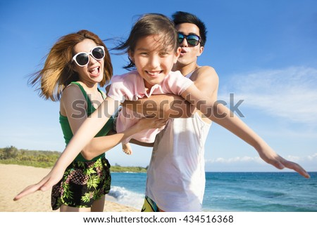 Happy young Family Having Fun at the Beach
