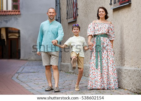 Happy young family in city street, Riga, Latvia