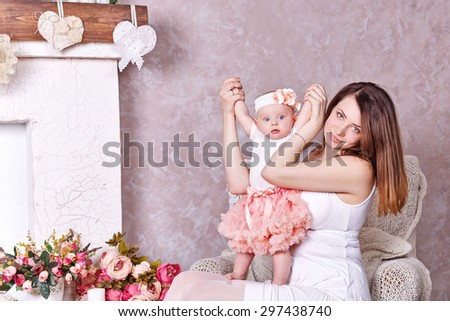 Happy young family, mother playing with little daughter. The concept of happiness of motherhood. - stock photo
