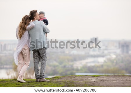 Happy young family on a background of the city - stock photo