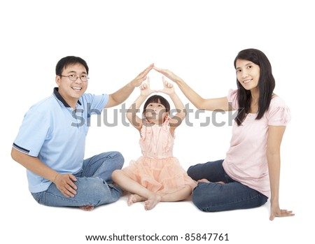 happy young family showing home sign by hands