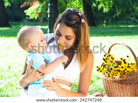 Happy young family spending time outdoor on a summer day. Mother and son. - stock photo