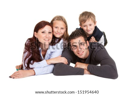 Happy young family spending time together. Isolated on white - stock photo